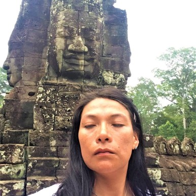 Angkor Thom Bayon numerous smiling stone faces by Jenny Rojas