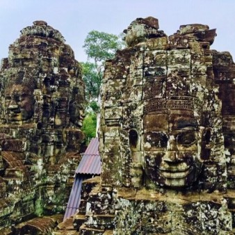 Angkor Thom Bayon numerous smiling stone faces3 by Jenny Rojas